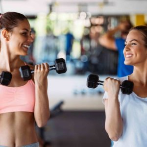 web_beautiful-women-working-out-in-gym-QJKGPH2