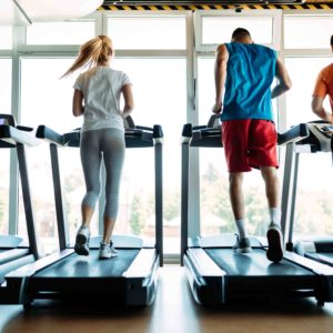 web_happy-people-on-treadmills-in-the-gym-PTW7LE6